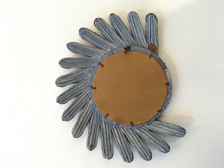 Unique aux exceptional asymmetrical mirror with a blue talosel resin frame. The petals are also in blue talosel resin with inlaid purple mirrors. Original back canvas. Signed Line Vautrin on the back on the circular frame and stamped ROI on the back