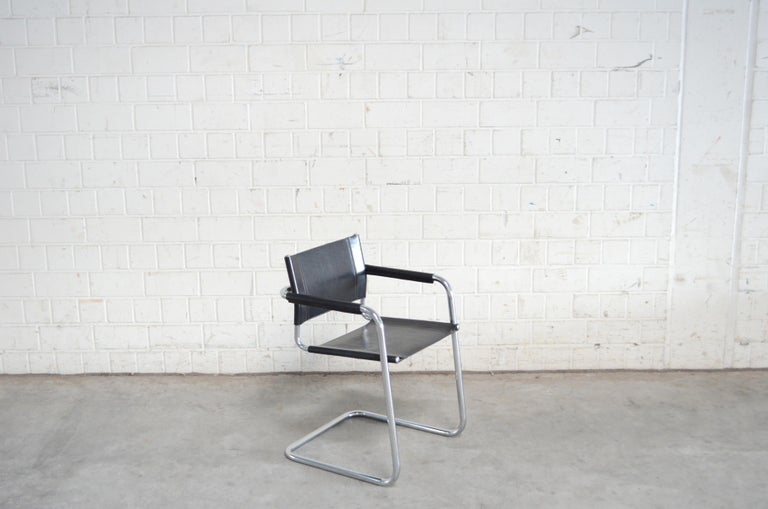 Cantilever chair by Italian manufacture Linea Veam. Tubular chrome steel frame and black saddle leather. This version is the dynamic type of cantilever chair with a little bend more on the front tubular. For comparison see the last picture with a