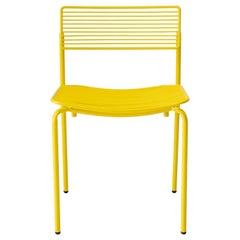Linear & Modern Yellow Metal Dining Chair