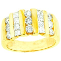 Linear Round and Princess Cut Diamond and Yellow Gold Ring