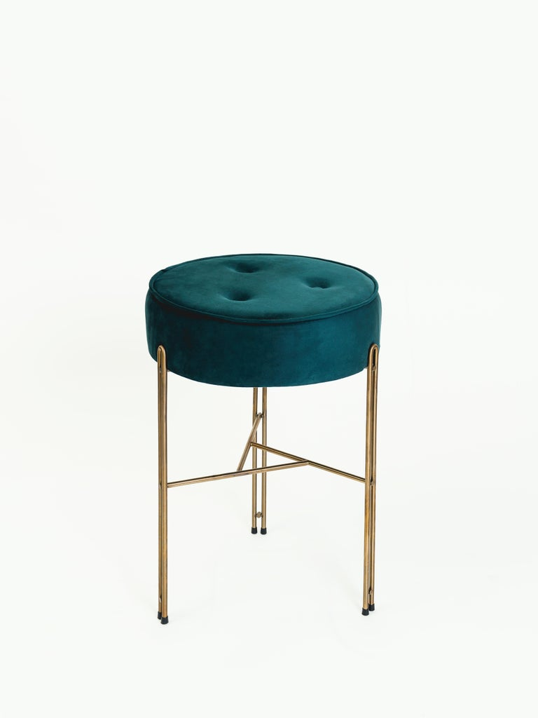 The Linha collection was designed from the top to bottom. The first piece of this collection is the planter pedestal. One of the other pieces in this collection is this upholstered stool.