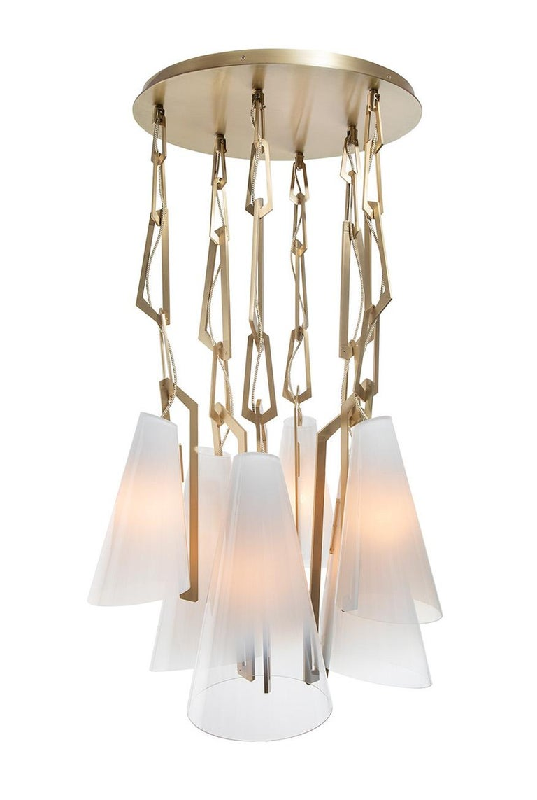 The link pendant combines hand blown glass with a dramatically scaled solid brass chain. Pendants can be used individually or clustered on a single ceiling plate as a chandelier.  Avram Rusu Studio is a Brooklyn based design studio known for