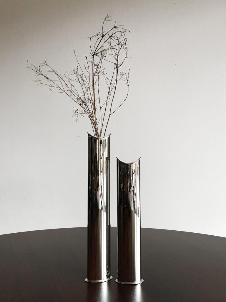 """Couple of Italian vases model """"Giselle"""" designed by LinoSabattini and produced by Sabattini Argenteria, marked under the base """"Sabattini Italy"""", 1970s."""