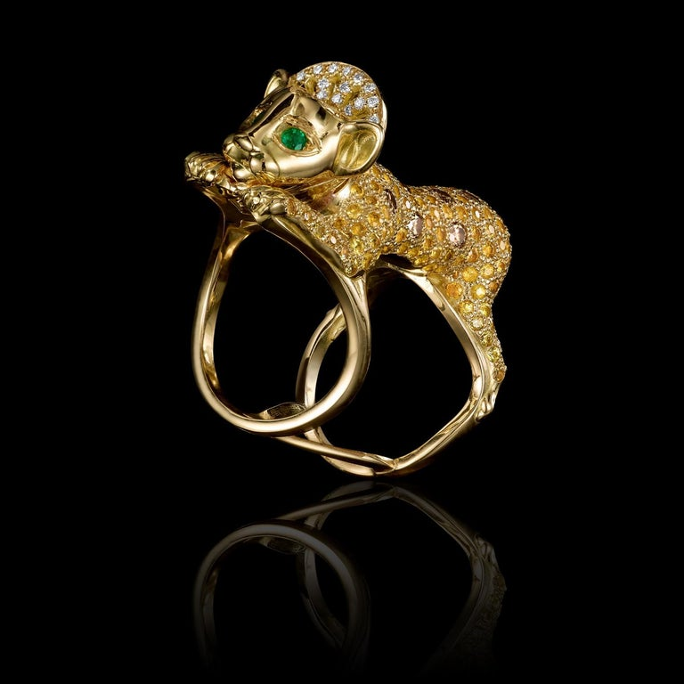 Lion Cub ring in 18K gold, cognac and clear diamonds pave and emerald eyes.   This ring depicts a young cub in a state of play – holding on to the wearer's finger and at the same time reaching toward something that caught its interest. Its soft