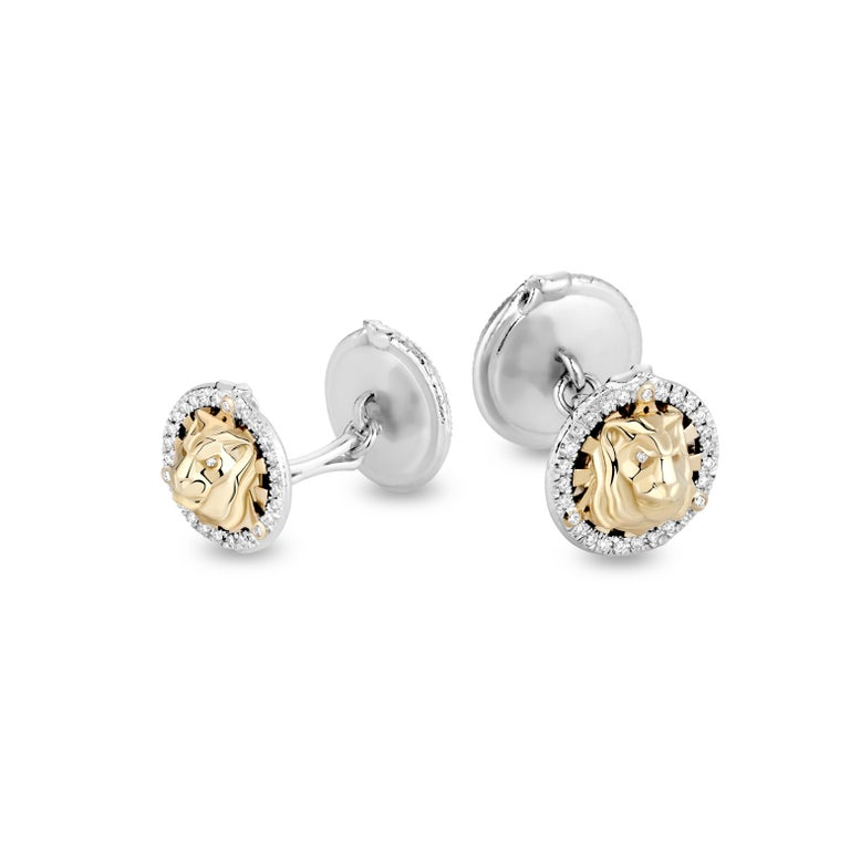 Lion cufflinks in 18K gold and diamonds are a must have accessory for a refined, luxurious man. They feature the face of a lion, surrounded by the rays of the shining sun, all placed within a triangle. Akin to the symbol of the all-seeing eye, the
