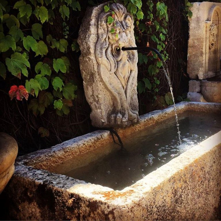 19th century large sculpture hand carved stone fountain head of a lion. It could be installed with a simple water spout or as is. You can pair it with a stone trough basin to create a charming garden water fountain feature we have many available