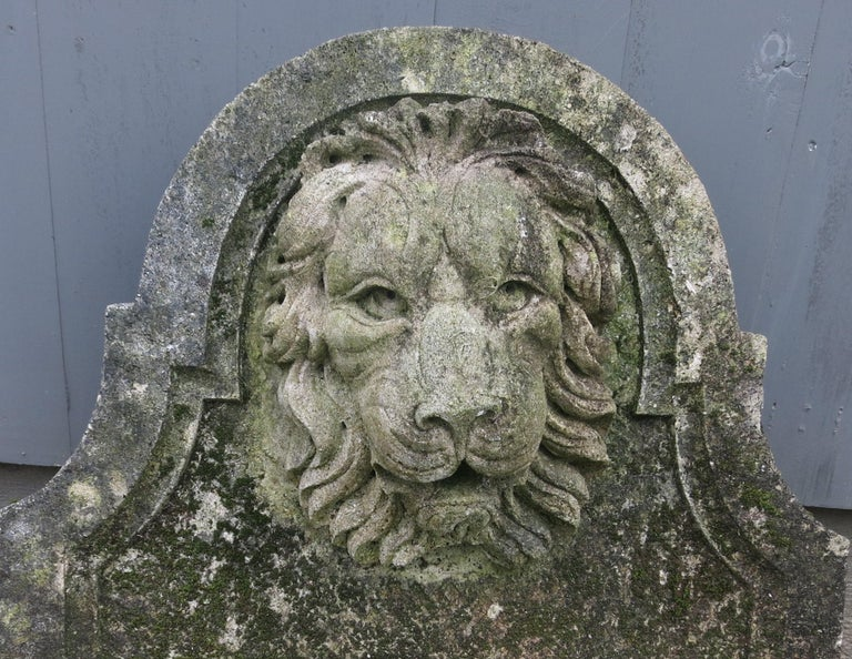 Lion head cast stone fountain back. Nice age and patina. It is 21.75