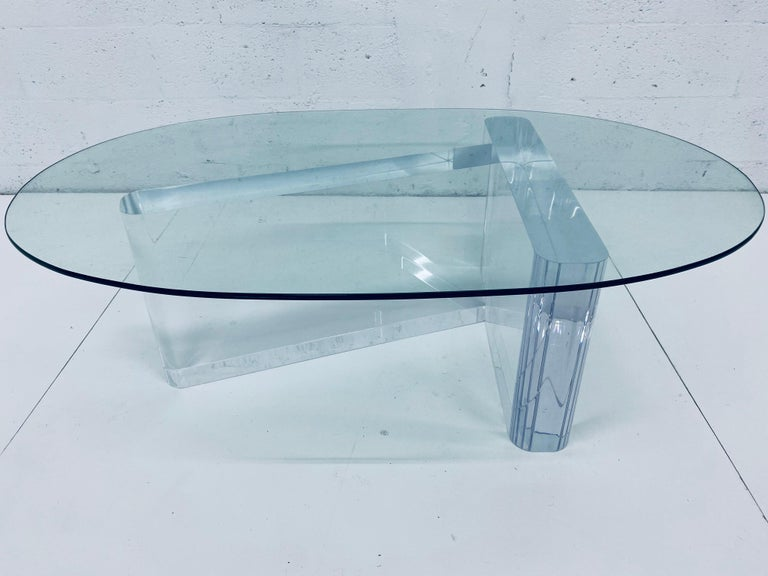 Sculptural Lucite coffee or cocktail table base with oval glass top by Lion In Frost from the 1970s, signed.   Lucite measures 4 inches thick. Use base with existing glass or have a new piece custom made. We can assist with new glass if required.