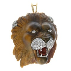 Lions Head Pendant/Brooch carved in Tiger Eye Stone