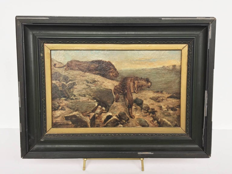 This tense landscape oil painting was completed in the early 20th century. It is signed Montoya at the bottom left. Besides this signature, not much else is known about the painter. The landscape portrays two lions, poised atop a craggy terrain,