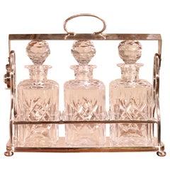 Liquor Tantalus in Silver Metal Three Crystal Bottles