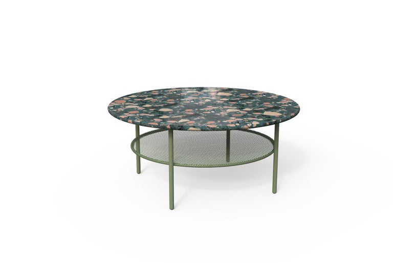 This fresh and colorful coffee table is ideal for outdoors although it combines perfectly with modern and fresh interiors as well. It's Terrazo top is a mixture of colored cement and marble stones. There are two versions of Terrazo that can be used