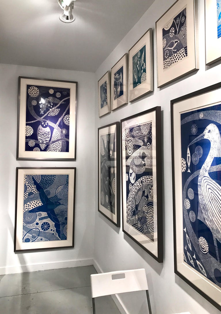 'Chittering and Chattering I'  Folk inspired blue/white linoleum print of bird - Contemporary Print by Lisa Houck
