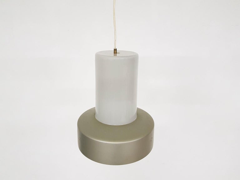 This item comes with free shipping to certain destinations. Please check ordering options.  Lisa Johansson-Pape model 61-013 glass and metal pendant light for Stockmann Orno, Finland, 1961  Lisa Johansson-Pape was probably the most important