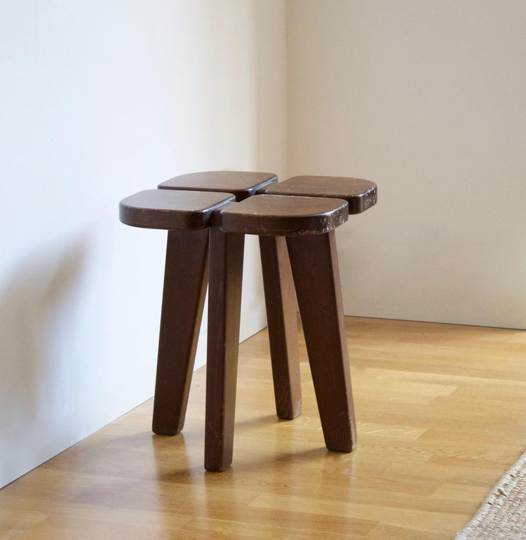 A stool, design attributed to Finnish Lisa Johansson-Pape, produced by Kervo Snickerifabrik for Oy Stockmann Ab, 1970s. In dark-stained pine.  Other designers working in similar functionalist ethos include Pierre Jeanneret, Pierre Chapo, Axel