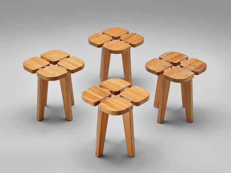 Lisa Johansson-Pape for Stockman Orno, 'Apila' stools, pine, Finland, 1960s.  Stools in solid pine. The design is simplistic: A clover top with four sloping legs. The construction of the stools is nicely visible on the top. Very elegant and