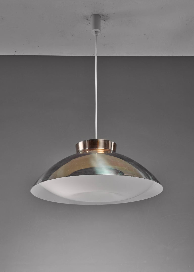 A large Lisa Johansson-Pape pendant lamp for Orno, in brass with a beautiful old plexiglass diffuser.