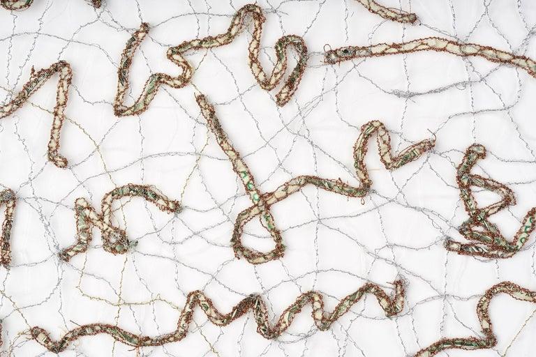 Shredded money and thread