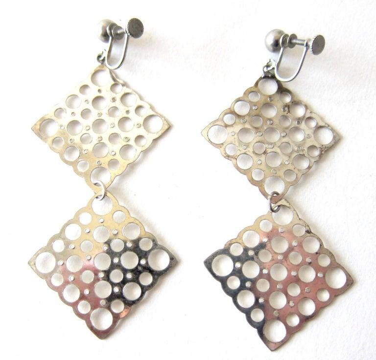 Vintage silver statement screwback earrings created by Liisa Vitali of Somero, Finland.  Earrings measure 3.5