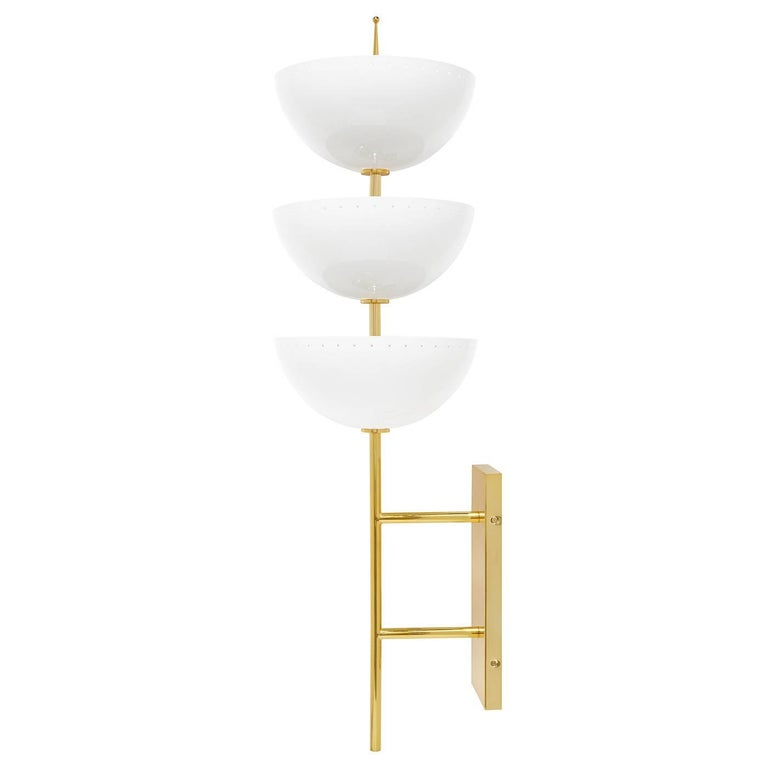 Magic mood. Large and in charge, our Lisbon sconce is a glamorous gesture that's just as elegant in a studio apartment as it is in an Italian palazzo. A polished brass stem supports three half spheres of ivory enameled metal with subtle round