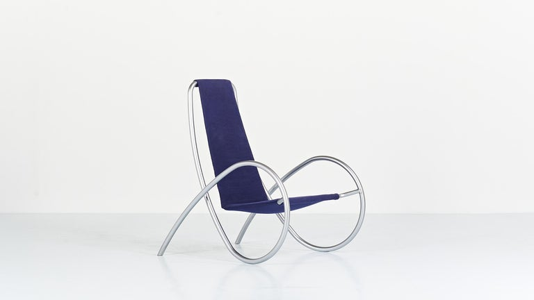 """Fjeder"" armchair, by designers Lise and Hans Isbrand for Isbrand Design. Suspended seat, upholstered in blue kvadrat fabric, supported by a satin chromed steel tubular structure. Presented for the first time in 1994. Small traces of use, including"