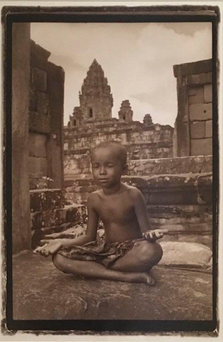 Little Buddha by Robert Curran Image size: 24 x 16 inches Framed 41.5 x 34 x 1 inches Archival pigment print/ signed by the artist 1998   Robert was born in Manhattan and moved to Cuzco, Peru, at a young age. He grew up amidst the remnants