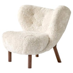 Little Petra Lounge Chair in Sheepskin with oiled Walnut Frame by & Tradition
