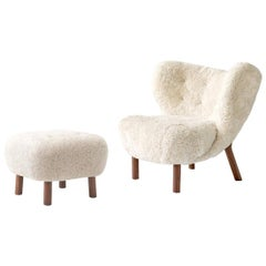 Little Petra Lounge Chair & Ottoman in Sheepskin with oiled Walnut Frame