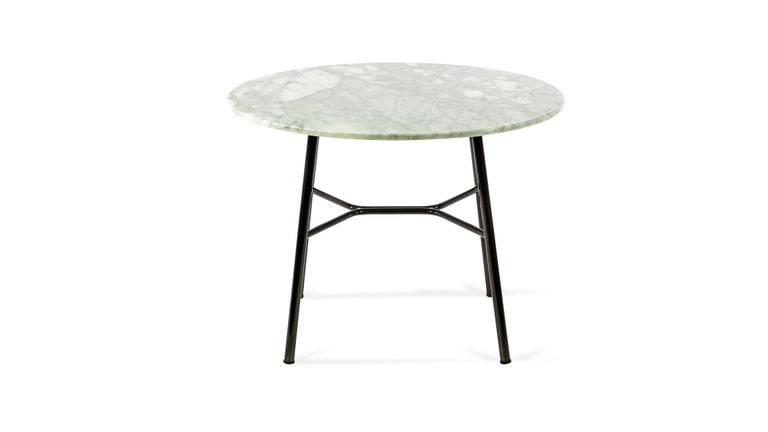 Coffee table, with metal frame, painted in standard or special colors, top available in glass ceramic color white Calacatta marble diameter 50 cm. height 45 It fits perfectly in a hotel lounge or home environment.