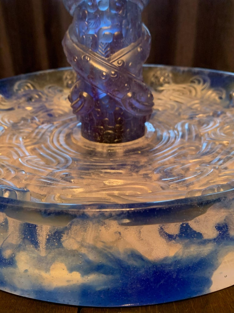 I have never had a piece of glass in the store that god has many compliments and comments as this piece. It is made by Liuli a Fine Art glassmaker in China with collectors and museums all over the world. According to the stidio, the piece is