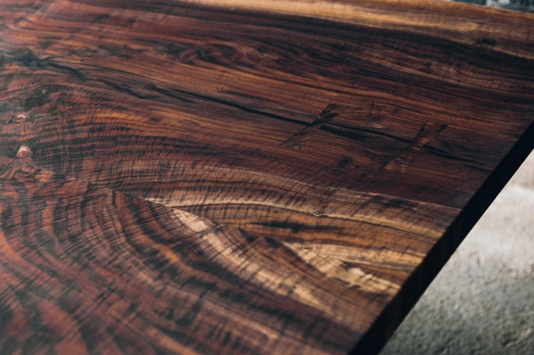 We specialize in slab tables like this. Live edge and refined, made for any space. This is a custom build and will take 12-14 weeks to complete. We will work with you on wood choices and slab selection. The base shown here is cast iron in black.