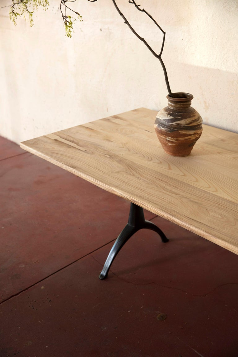 Contemporary Live Edge Dining Table Light Color Wood on Black Patina Cast Wishbone Base For Sale