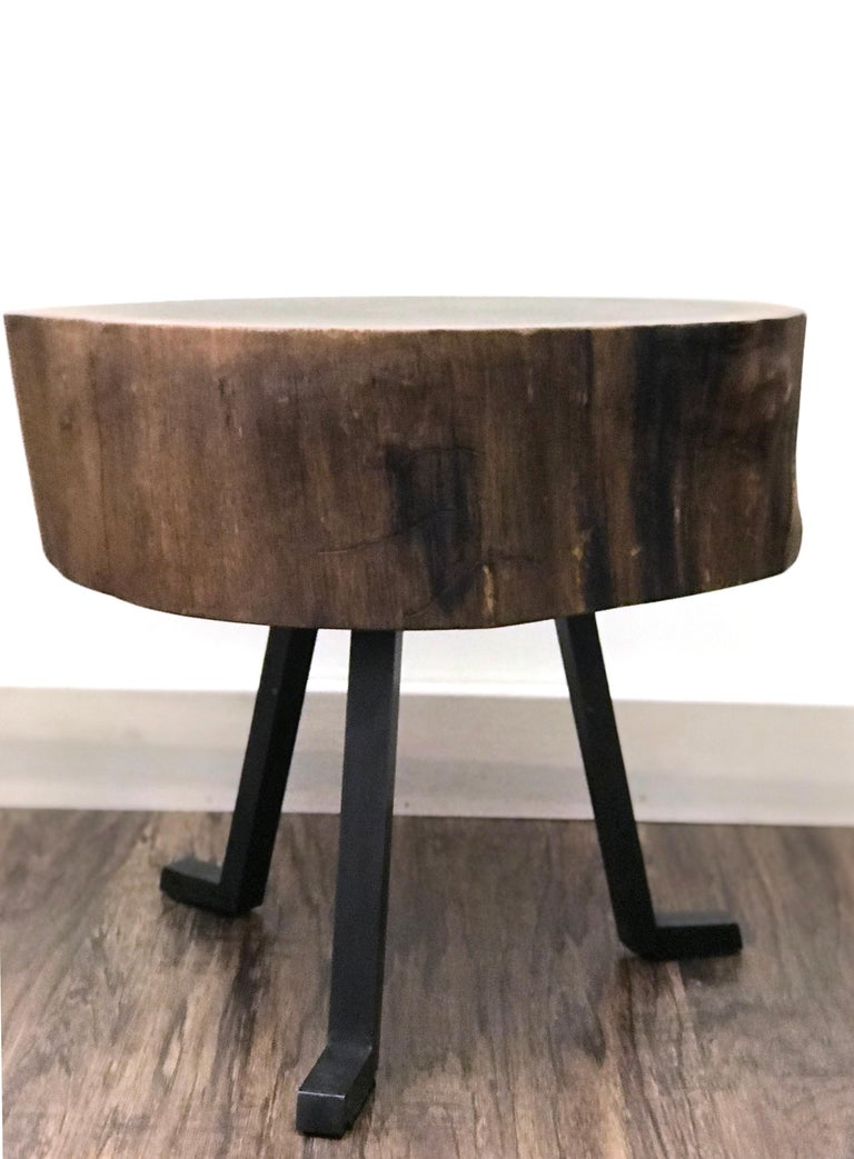 This Live Edge round side table in walnut is an occasional table, a coffee table, or a side table. We call it the Sputnik table. It is certainly irregular and that's why you'll love it. The three metal legs attached to live edge piece timber evoke