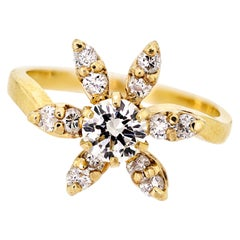 Lively Diamond and 14 Karat Yellow Gold Flower Ring