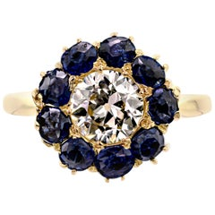 Lively Old European Cut Diamond and Sapphire Halo Ring