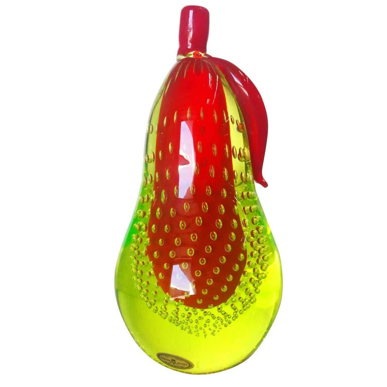 Beautiful Murano handblown art glass with red over green and controlled bubbles. The set features a pear with an apple, each with a polished side and bottom. They make great BookEnds  Signed Livio Seguso, circa 1960.  Italy, circa 1960.  Born in