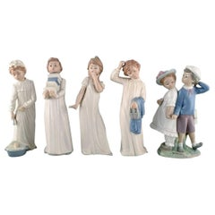 Lladro and Nao, Spain, Five Porcelain Figurines of Children, 1980s-1990s