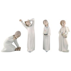 Lladro and Nao, Spain, Four Porcelain Figurines of Children, 1980s-1990s