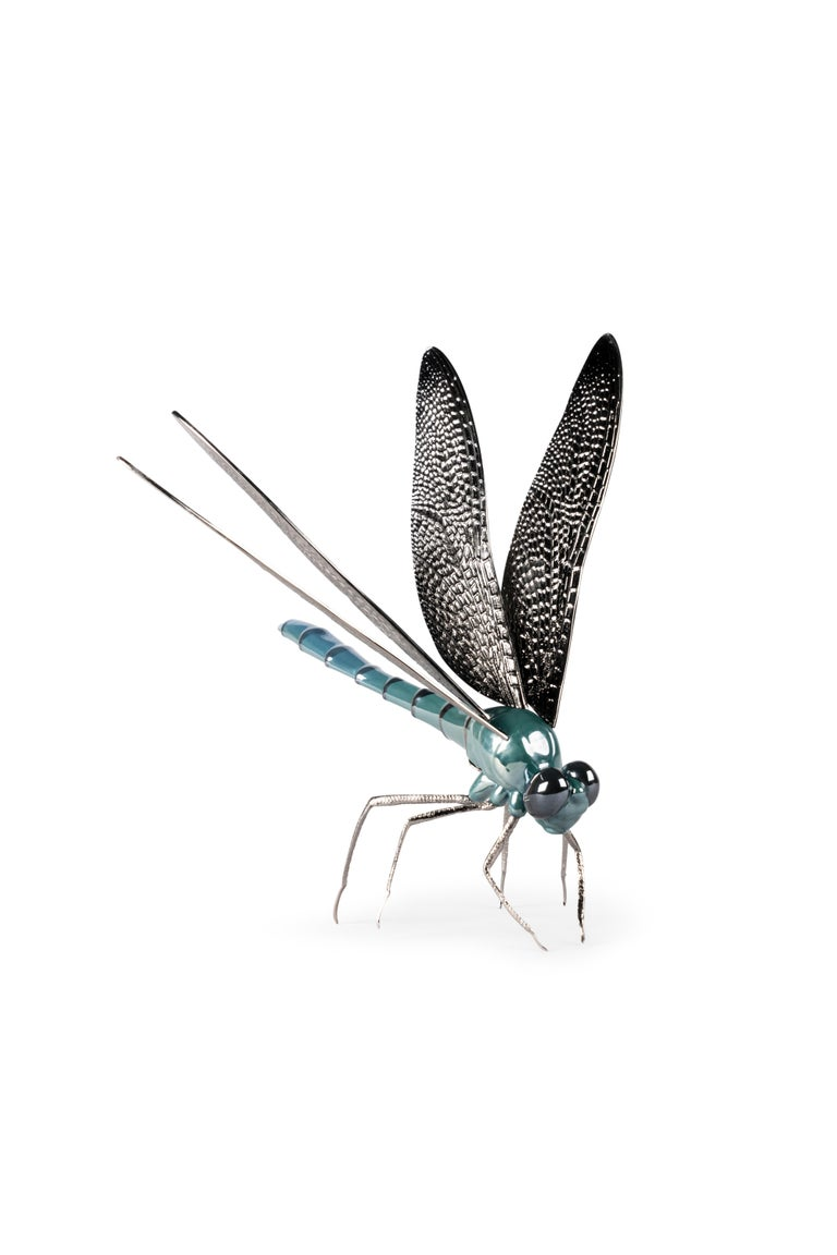 An innovative porcelain and metal creation inspired by one of the fascinating creatures in nature. Part of the Awesome Insects Collection. This original piece is made in glazed porcelain and decorated with pearl luster. The legs and wings are in