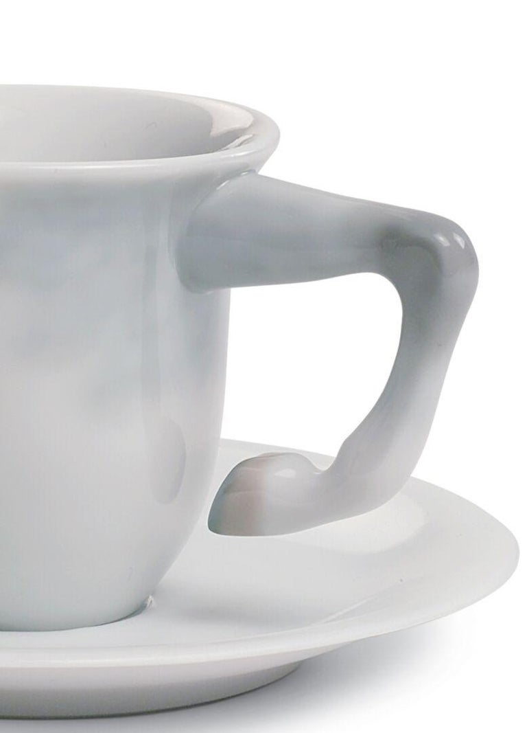 Coffee cup in white glossy porcelain designed by Bodo Sperlein from the Equus collection. This coffee cup and saucer is part of the Equus series, one of the most innovative and bold projects of Lladró's Atelier concept. It's the result of a
