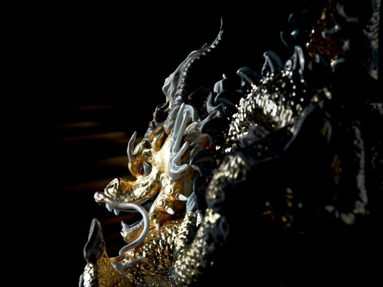 Limited edition dragon sculpture in matte porcelain with gold lustre. A symbol of power and prosperity in Eastern culture, this magical creature, the bearer of good luck, is the protagonist in this spectacular High Porcelain limited edition. The