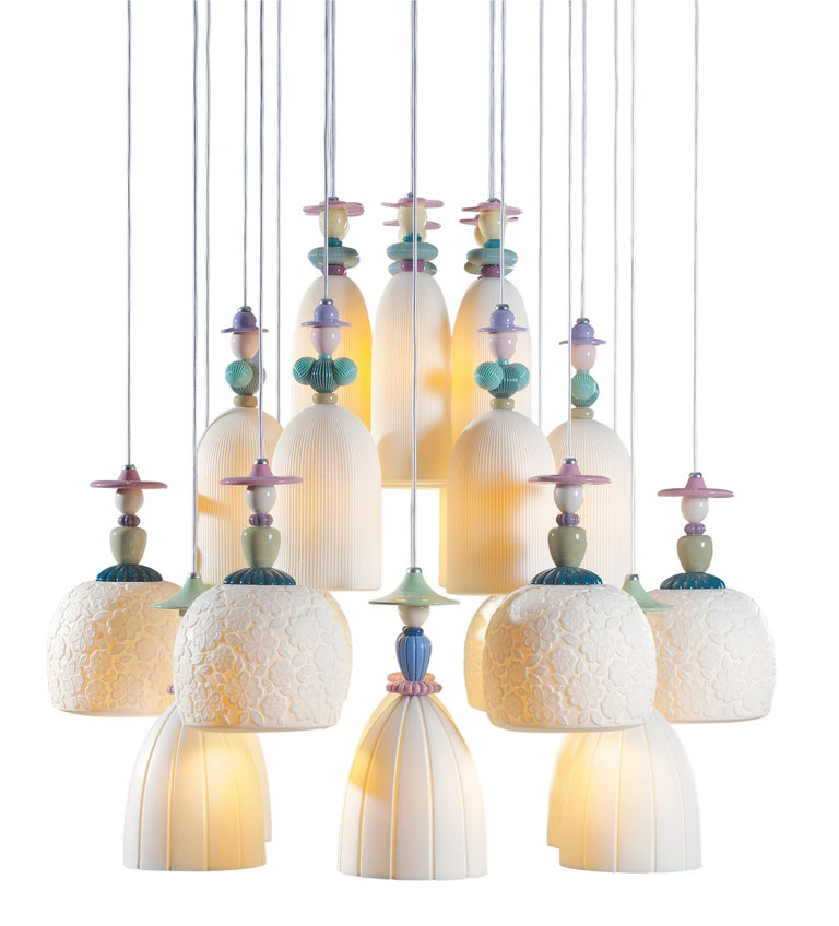 Handmade hanging ceiling lamp in brightly colored porcelain and floral decorations with twenty-four engraved translucent white porcelain tulips. The Mademoiselle collection is inspired by Lladró's romantic ladies, one of his most traditional motifs,