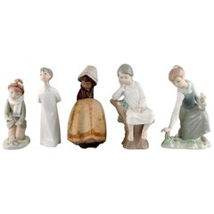 Lladro, Nao and Zaphir, Spain, Five Porcelain Figurines of Children, 1980s-1990s
