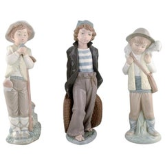 Lladro, Nao and Zaphir, Spain, Three Porcelain Figurines, Young Boys, 1980s