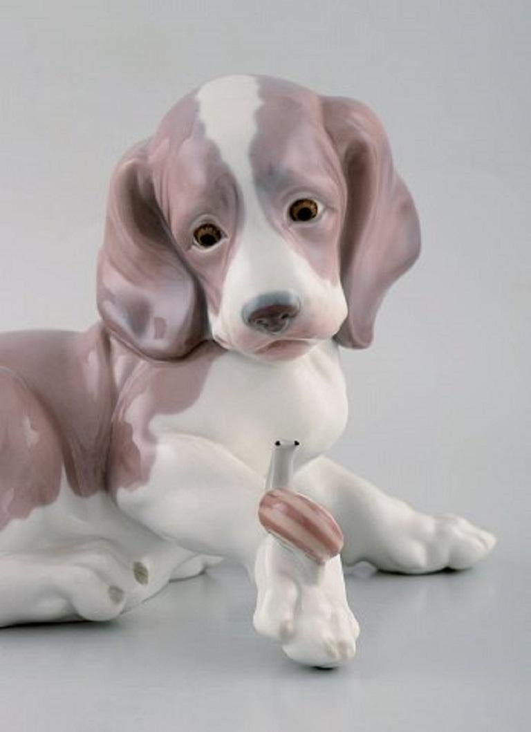 Lladro, Spain. Figure in glazed porcelain. Puppy and snail, 1980s.