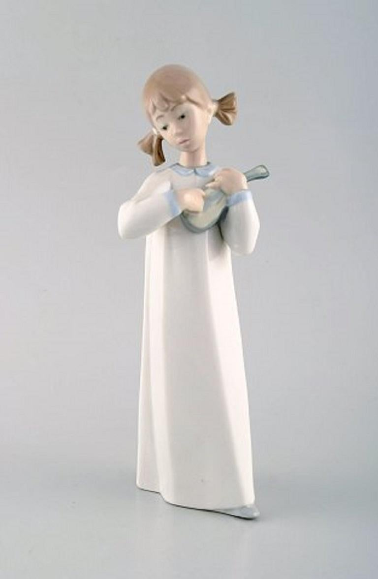Lladro, Spain, Four Porcelain Figurines, Children with Instruments, 1980s For Sale 1