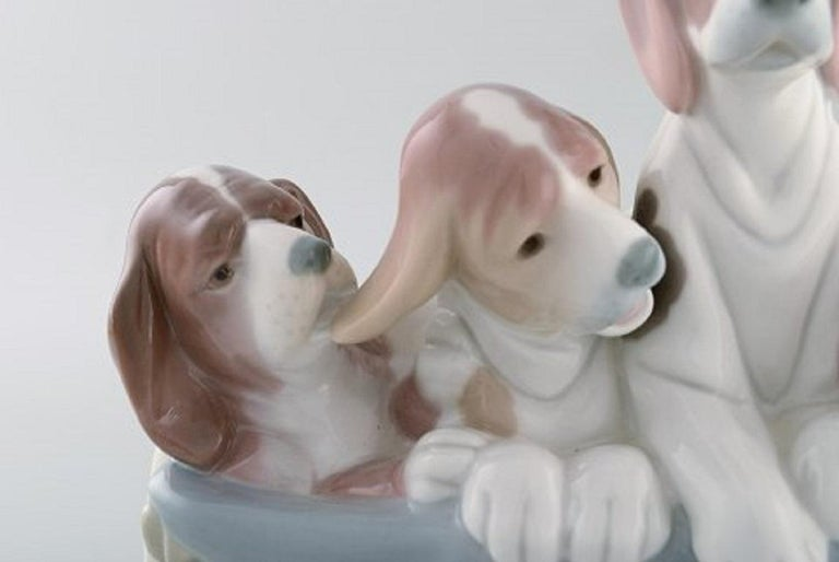 Late 20th Century Lladro, Spain, Large Figure in Glazed Porcelain, Four Puppies in a Basket, 1980s For Sale