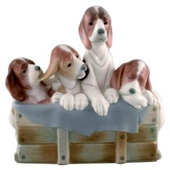 Lladro, Spain, Large Figure in Glazed Porcelain, Four Puppies in a Basket, 1980s