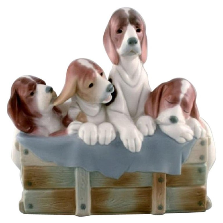 Lladro, Spain, Large Figure in Glazed Porcelain, Four Puppies in a Basket, 1980s For Sale