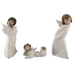 Lladro, Spain, Three Porcelain Figures of Young Angels, 1970s-1980s